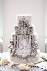 wedding cake theme this winter themed wedding cake features two sets of footprints