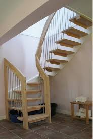 deluxe wooden modern staircase with simple iron pipe banister as