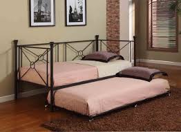 furniture black metal daybed with pink and purple bedding placed