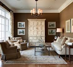 circle table front beige sofa behind wall art and stunning living