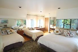 the cabana building maui farm stay at hale akua garden farm cabana garden room this room is located on the second level of the cabana building with a balcony pool and garden views this room is deal for a family or
