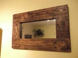 glamorous bathroom wall mirror with brown stained oak wood frame