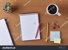 writing paper with space for picture office desk table blank notebook cup stock photo 455598292 office desk table with a blank notebook cup of coffee red pen pencil
