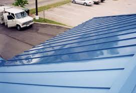 faded painted metal roof restored