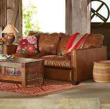 Rustic Leather Armchair Augusto Chair And Ottoman Teak Ottomans And Leather Sofas