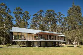 self sufficient flood proof home floats over australian bushland country homes outdoor areas water collection