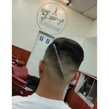 drop skin fade hair blow dried to give it natural volume haircut