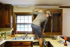 how to get rid of new kitchen cabinet smell removing some kitchen cabinets rehanging one house