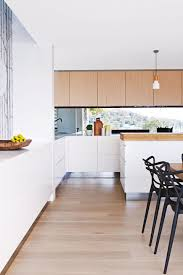 various white kitchen floorboards timber cupboards cabinetry black