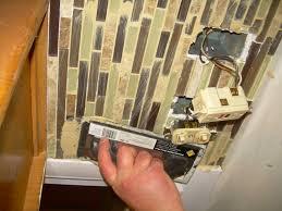 installing glass tiles for kitchen backsplashes kitchen backsplash black backsplash tile kitchen backsplash