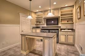 wainscoting backsplash kitchen traditional laundry room with high ceiling pendant light in