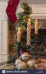 fireplace christmas candles stock photos fireplace christmas living room decorated for christmas with candlesticks and a stocking hung at the fireplace mantle