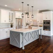 white kitchen cabinets with colored island 5 ways to work with white kitchen cabinets