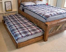 How To Build A Platform Bed With Trundle by Diy Rolling Trundle Bed Plans Infarrantly Creative