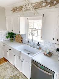 painting kitchen cabinets tutorial diy cabinet painting you can a fresh new look on a budget