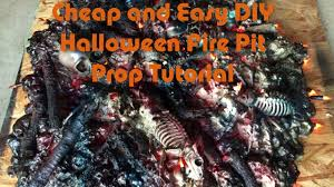 diy cheap and easy halloween spooky fire skull pit prop decoration