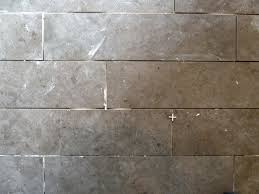 what are reasonable expectations about grout width accuracy in a