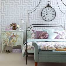modern country style bedroom with wallpaper and clock with canopy