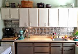 Backsplashes For White Kitchen Cabinets White Wall Kitchen Cabinet Design With Tin Backsplash And Quartz