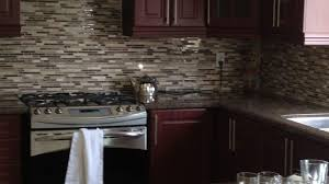 backsplash for black cabinets stone slab flooring double black