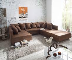 sofa braun clovis braun 300x185 cm mit hocker und kissen wie