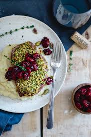 elegant dinner recipes pistachio crusted lamb chops with red wine cherries running to