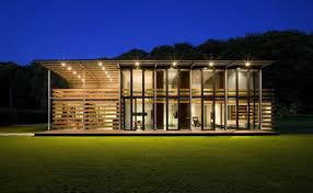 redesigned barn house into modern house design with metal roof