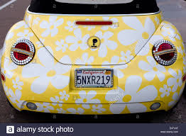 yellow volkswagen beetle royalty free tweety version of a vw beetle with flower decoration and