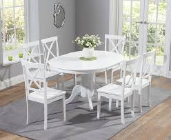 white dining room table extendable buy the epsom white pedestal extending dining table set with chairs