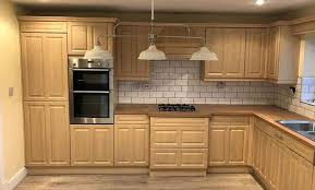 kitchen cabinet doors only uk how much does it cost to spray paint kitchen cabinets