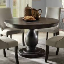 round dark wood pedestal dining table why opt for a round pedestal dining table blogbeen