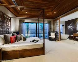 master bedroom designed with asian theme using wooden canopy bed