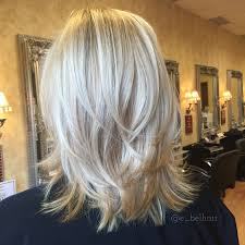 putting layers in shoulder length hair shoulder length cut with tousled layers and fresh blonde color
