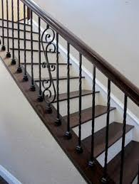 wrought iron stair railing uncarpeted stairs there are