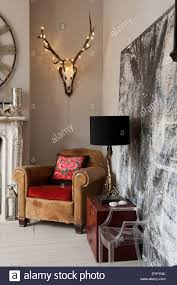 Fairy Light Wall by Fairy Lights Adorn A Mounted Stag Head With Antlers On Wall Above
