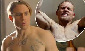 beat the devil s tattoo korean movie shirtless charlie hunnam shows off his muscles in papillon trailer