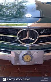 green mercedes green mercedes benz antique car display in old town area at