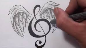tattoos designing a treble clef with wings
