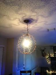 Repurposing Old Chandeliers Made This From Old Couch Springs I Love It Repurposed