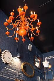 restaurant visit bowery beef in new york orange chandeliers