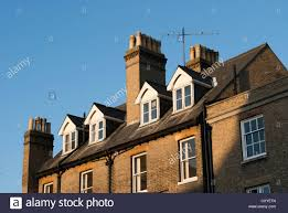Dormer Building Roof Chimneys And Upper Story Of Building With Dormer Windows In