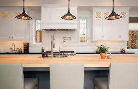 gray kitchen island with maple countertops and light gray leather