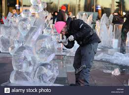 making ice sculpture on the plaza next to the winter garden in