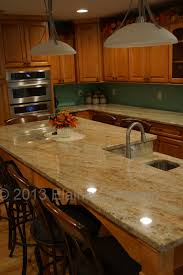 Kitchen Granite by Medallion Designer Cabinetry Windwood Maple Door Hazelnut