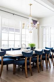 white wood dining table with blue velvet dining chairs