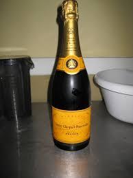 cosmopolitan bottle mimosas and coq au champagne oui oui fashionably cosmopolitan