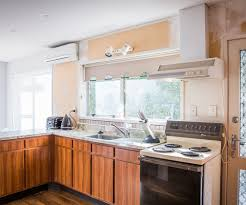 mitre 10 kitchen cabinets this kitchen went from dull and dark to light and bright
