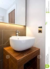 Stylish Design Bathroom Detail Of A Stylish Designer Hand Wash Basin With Woode