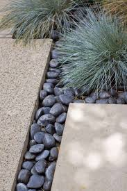 Large Pebbles For Garden Beach by I Like The Black Rocks With Concrete Paving Stones Exterior