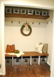 turning a foyer closet into a mudroom ish space love the hidden